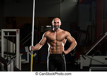 Portrait Of A Physically Mature Man With Javelin