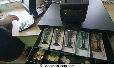 Ticket window and cash register drawer with russian...