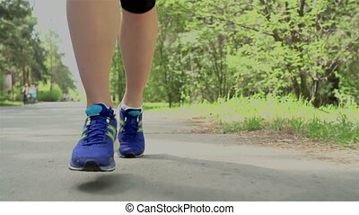 Beneficial Exercising - Tracking close up on legs of...