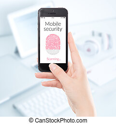 Close up mobile security smartphone fingerprint scanning -...