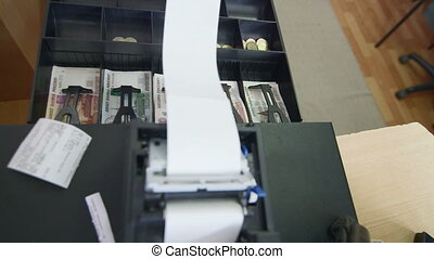 Cashier loading cash register paper roll