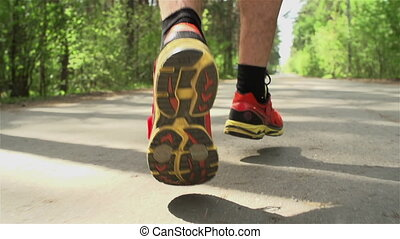 Staying Healthy - Dutch angle of male hairy legs running in...