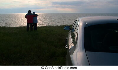 Couple traveling to the sea shore by car - Adult couple...