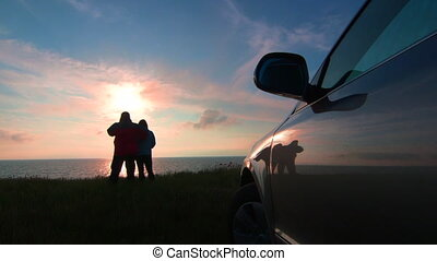 Traveling to the sea shore by car - Adult couple traveling...