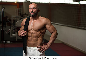 Sexy Muscular Man With Black Belt On Shoulder - Portrait Of...