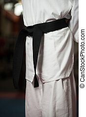 Black Belt Fighter - Man In A White Kimono And Belt For...