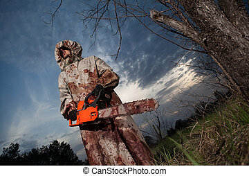 Maniac with the chainsaw dressed in a dirty bloody raincoat...