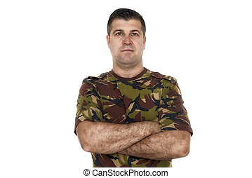 Military serviceman with his arms crossed
