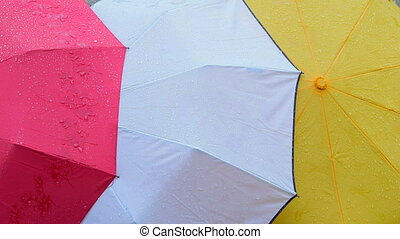 Wet colored umbrellas background
