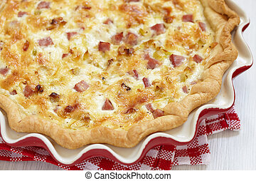 quiche lorraine - pie with cheese, ham and leek