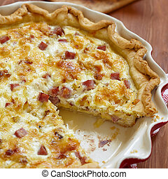 quiche lorraine - pie with cheese, ham and leek
