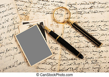 Picture and letters with fountain pen and magnifying glass