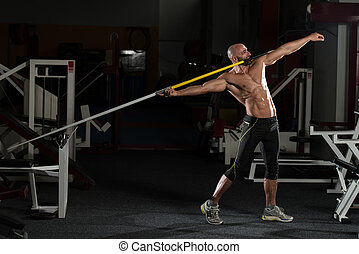Side view Of Muscular Bodybuilder Throwing Javelin - Mature...
