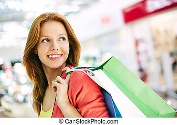 Friendly consumer - Portrait of happy girl with shopping...