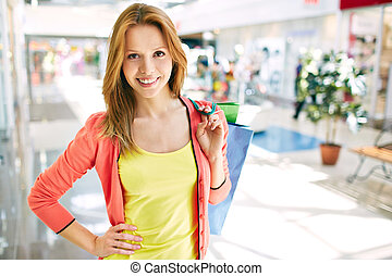 Consumer in the mall - Portrait of pretty consumer with...