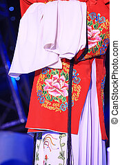 red PingJu traditional dress, closeup of photo
