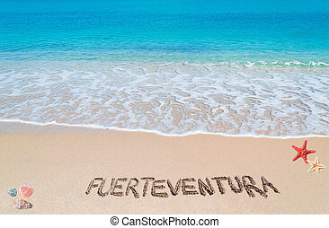fuerteventura writing - turquoise water and golden sand with...