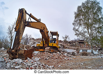 Old excavator on the ruins of an old house - Remains of old...