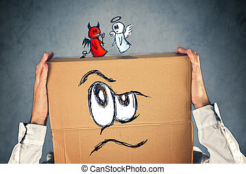 Businessman with a cardboard box on his head with doodle drawing of angel and devil fighting. Concept of conscience; decisions, uncertainty, moral dilemma; fight of good and evil.