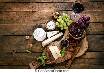 Cheese variety Food background Fresh ingredients on wood