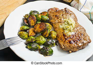 Beef steak with garlic butter and brussel sprouts -...