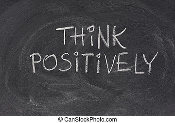 think positively slogan on blackboard - think positively...