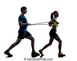 one woman exercising resistance rubber band fitness workout with man coach in silhouette on white background