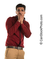 Frightened man - Handsome young Indian man with a frightened...