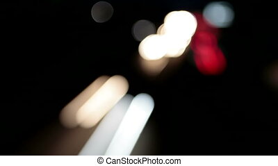 Traffic at night. Timelapse, defocused