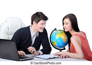 Tourism - Travel agency. Man and woman at office decide to...