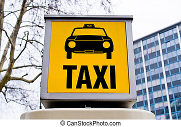 Taxi sign with car
