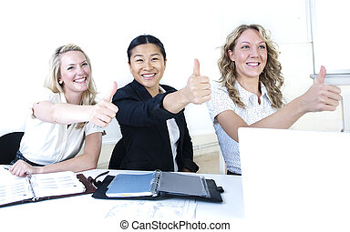 Group of business women giving thumbs up