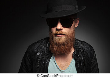 young man with a long red beard - portrait of a casual young...