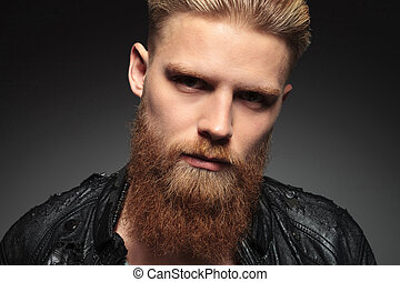 portrait of a young bearded man - close up of a casual young...