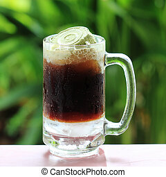 Root beer float a tasty summer treat on Green tree backgroun