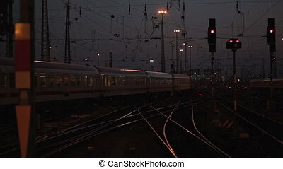 Traffic at the railway station - Departing train at dusk