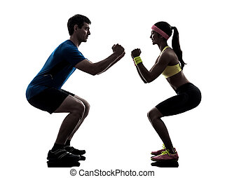 woman exercising fitness workout with man coach silhouette -...