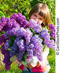 photo of the spring girl with lilac bouquet