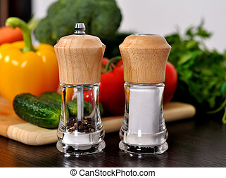 pepper  and salt mills on kitchen table