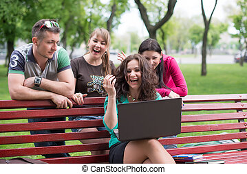 Happy group of young students sitting