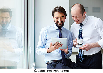 Ideas on project - Image of young businessman holding...