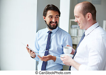 Business discussion - Image of young businessman holding...