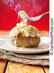 Jacket potato - Steaming hot oven baked potato with melting...