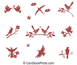 Silhouettes of birds on branches