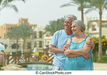 Senior couple resting at the resort during vacation