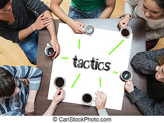 The word tactics on page with people sitting around table...