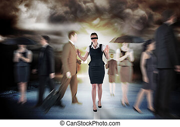 Composite image of redhead businesswoman in a blindfold -...