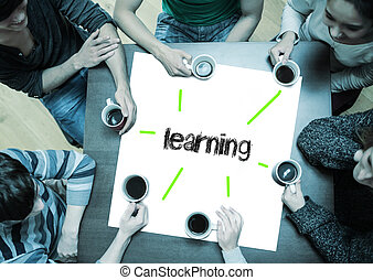 The word learning on page with people sitting around table...