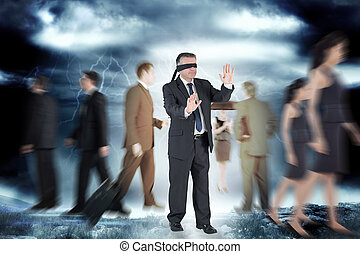 Composite image of mature businessman in a blindfold -...