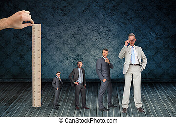 Composite image of hand measuring stages of businessmans...